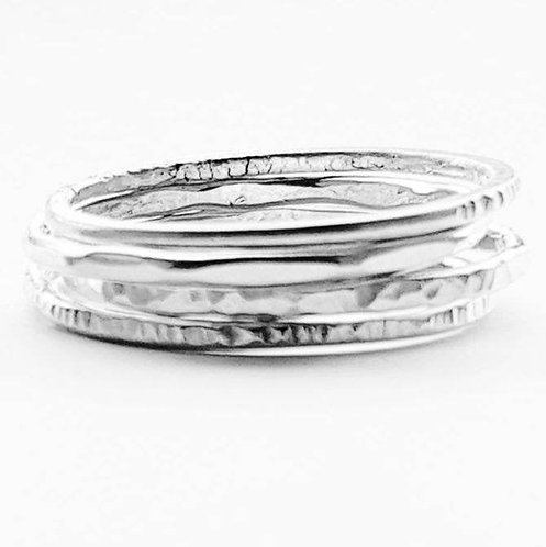 Four sterling silver stacking rings.