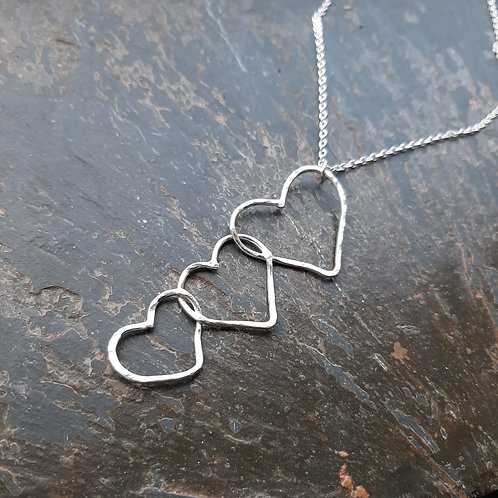 3 sterling silver hanging fixed hammered hearts