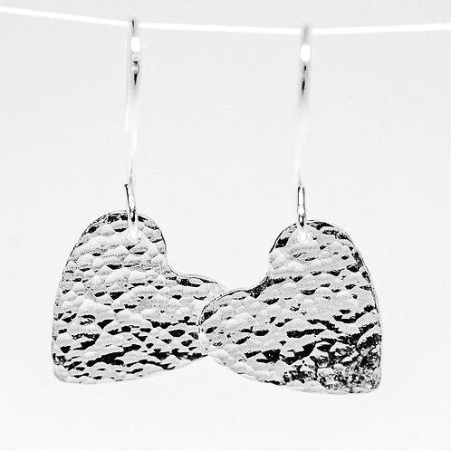 Sterling silver hammered heart earrings.