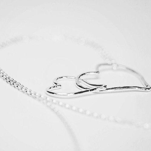 2 sterling silver hanging loose hammered hearts