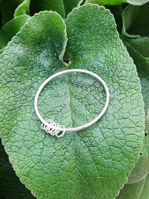 Heavy silver bangle with silver circles