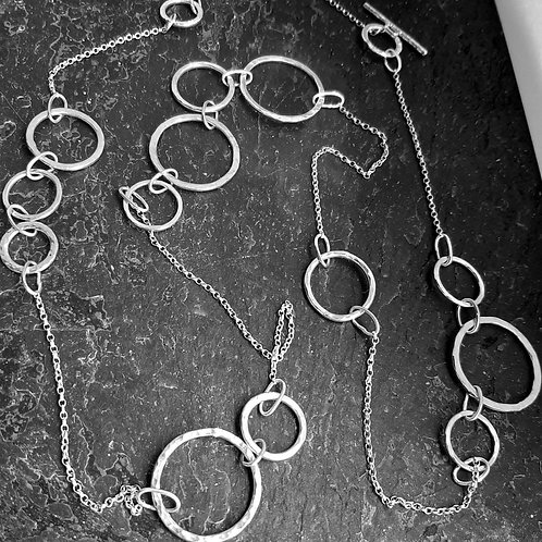 Unique contemporary long sterling silver circles necklace