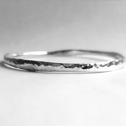 Uneven hammered silver bangle