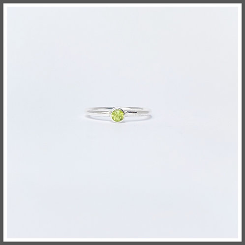 Peridot gemstone ring. August birthstone