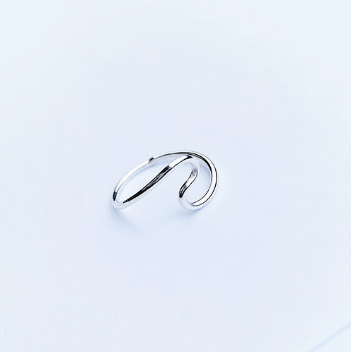 Silver wave ring. Plain texture.