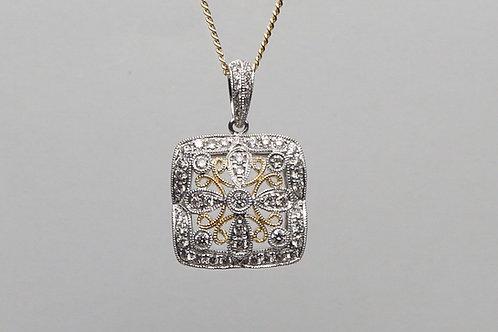 14 karat yellow gold and white gold diamond pendant