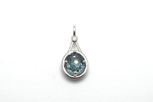 14 karat white gold diamond and green topaz pendant
