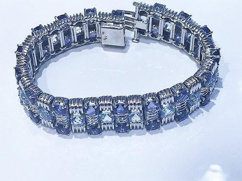 14 karat white gold blue topaz and iolite bracelet