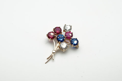 14 karat yellow gold pin with synthetic stones