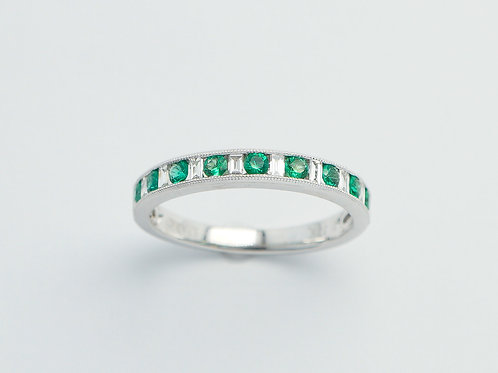 18 karat white gold emerald and diamond ring
