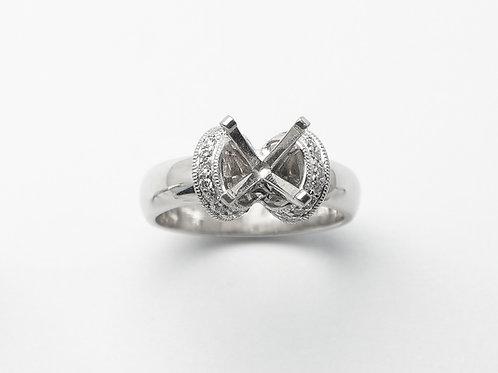 Platinum and 18 karat white gold semi mount diamond engagement ring
