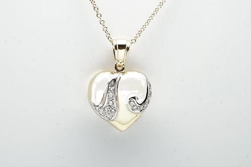 18 karat yellow gold and white gold diamond heart pendant