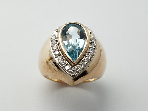 14 karat yellow gold blue topaz and diamond ring