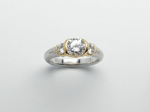 Platinum and 18 karat yellow gold semi mount diamond engagement ring