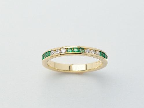 18 karat yellow gold emerald and diamond ring