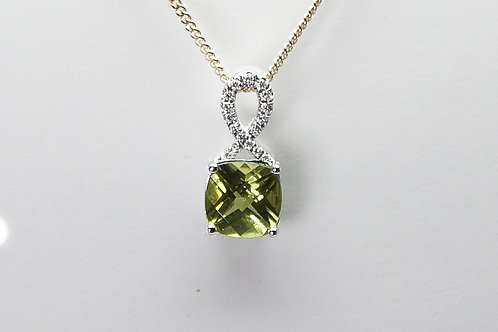 14 karat white gold peridot and diamond pendant