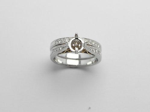Platinum and 18 karat yellow gold semi mount diamond engagement set