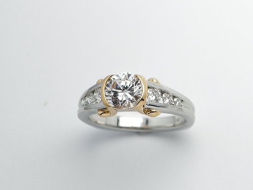 Platinum and 18 karat semi mount diamond engagement ring