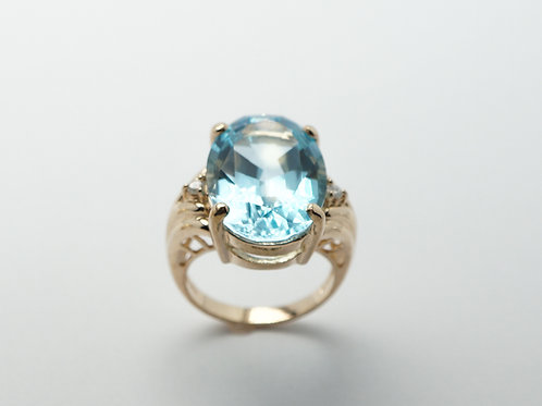 14 karat yellow gold blue topaz and diamond ring