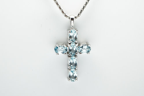 14 karat white gold blue topaz cross pendant