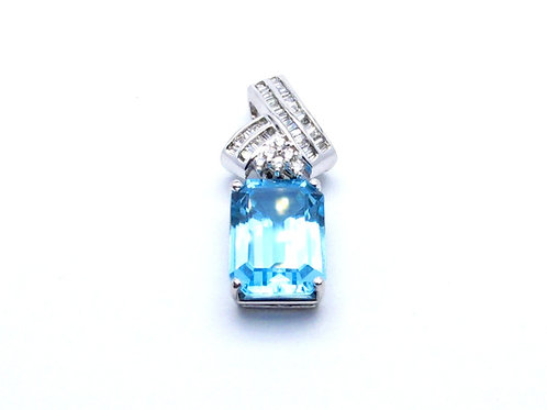 14 karat white gold blue topaz and diamond pendant
