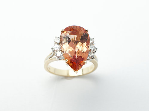 14 karat yellow gold and white gold imperial topaz and diamond ring