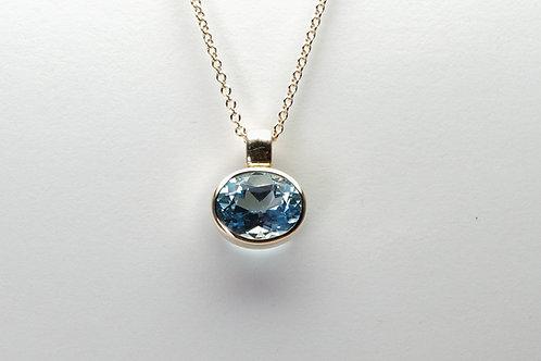 14 karat yellow gold blue topaz pendant