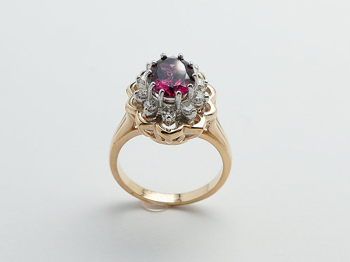 14 karat yellow gold and white gold garnet and diamond ring