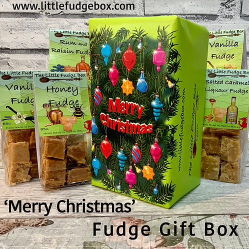 Box of handmade Welsh fudge from The Little Fudge Box wrapped in hand drawn Christmas tree branches and colourful baubles.