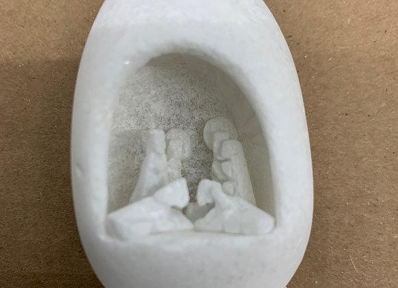 Egg shaped limestone nativity scene