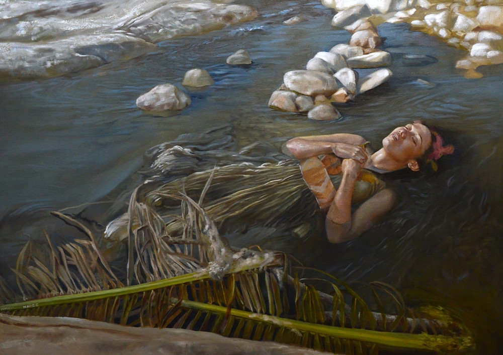 Indigenous woman floating in the river