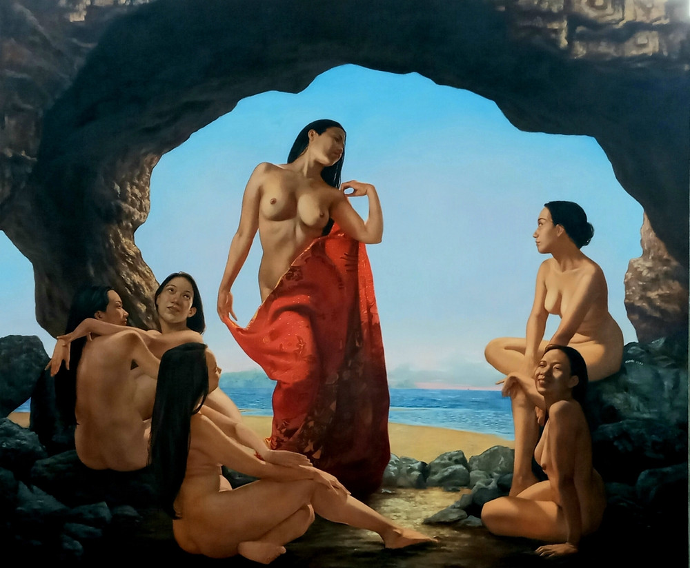Nude women hanging out by the sea