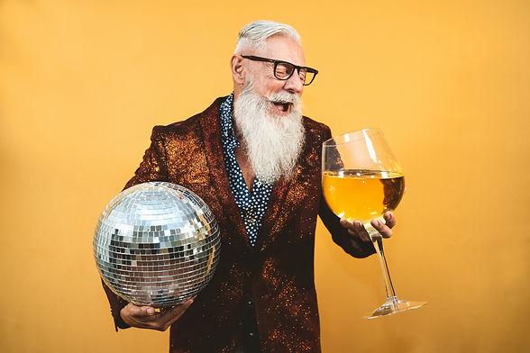 Senior party man celebrating new year's eve in disco club .jpg
