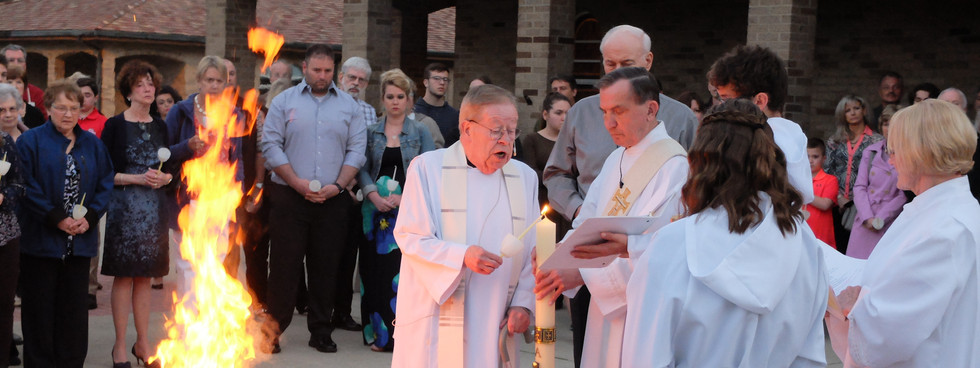 Father Lights the Paschal candle