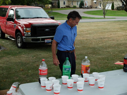 Jim serves the Knights' beverages.