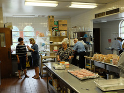 Many helping hands in the kitchen.