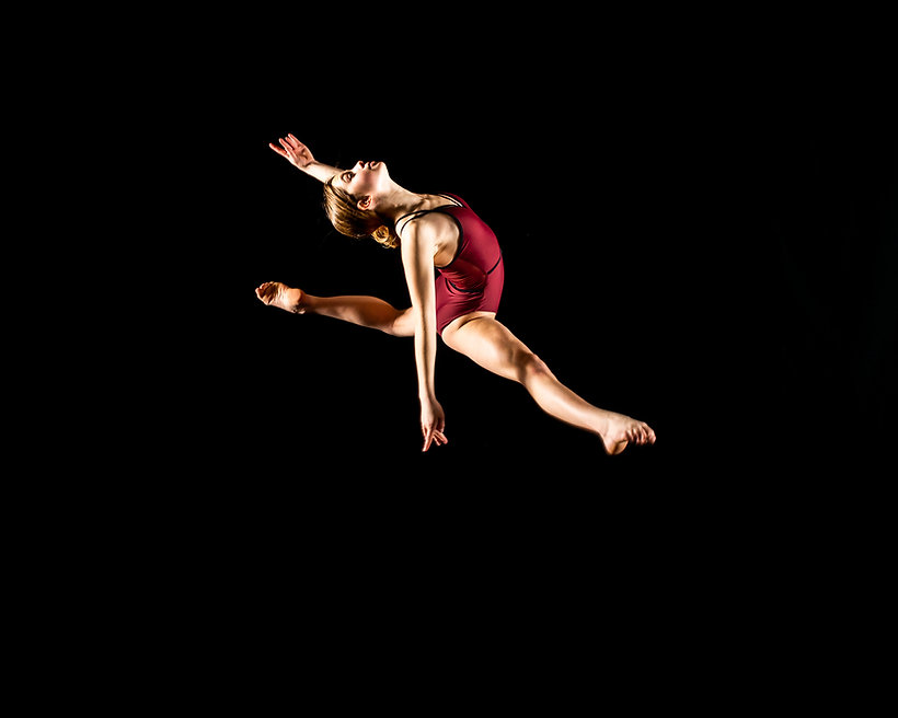 Solo dancer jumping female back attitude, arm in fifth position.