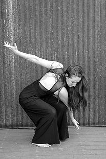 female dancer in black stretched