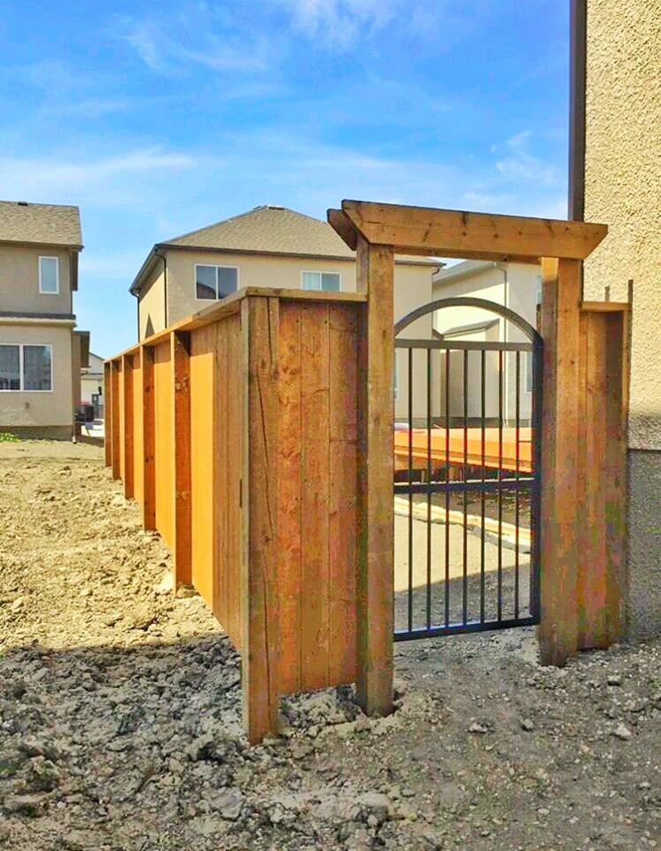 wood fence with round top iron