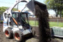 Bobcat_dumping_soil.15131154_std.jpg