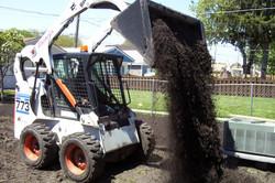 Bobcat_dumping_soil.15131154_std