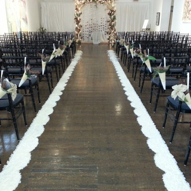 Ceremony with hopa and black chairs.jpg