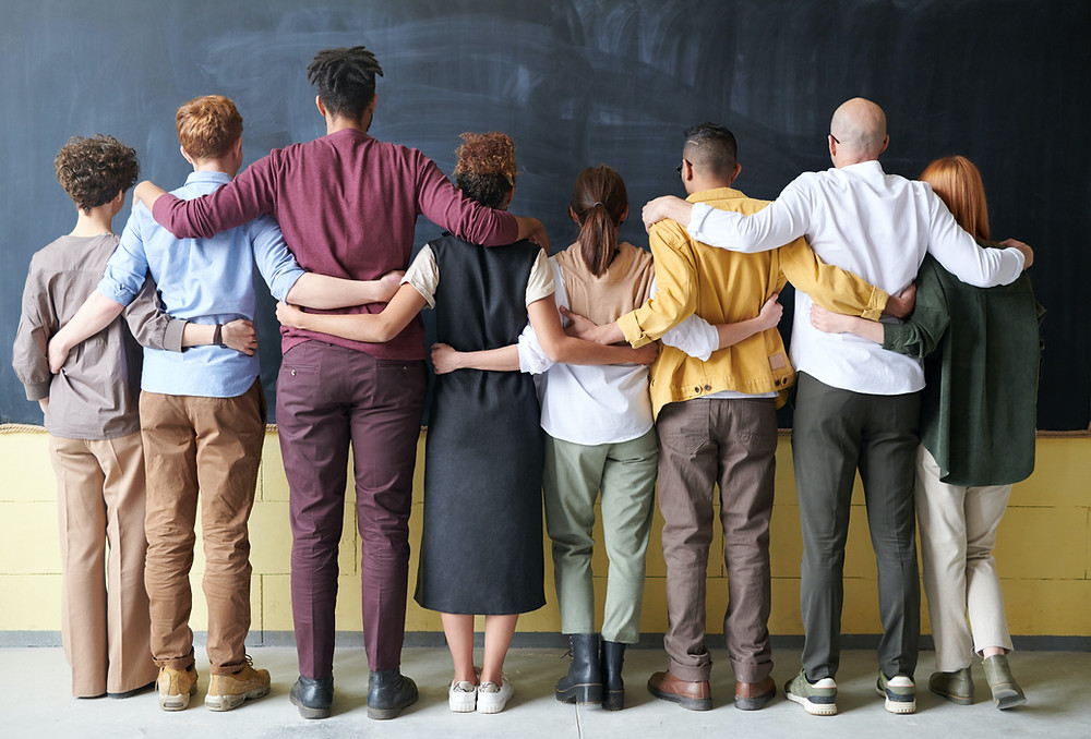 A team bound together facing a blackboard