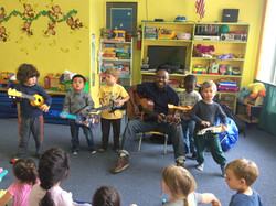 Rado and students playing music