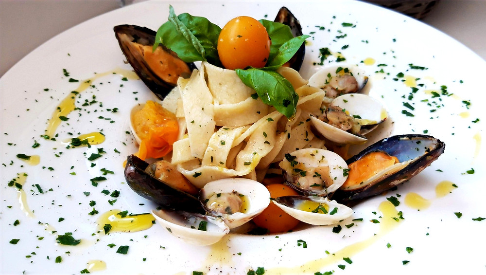Homemade tagliatelle with clams, mussels and yellow cherry tomatoes
