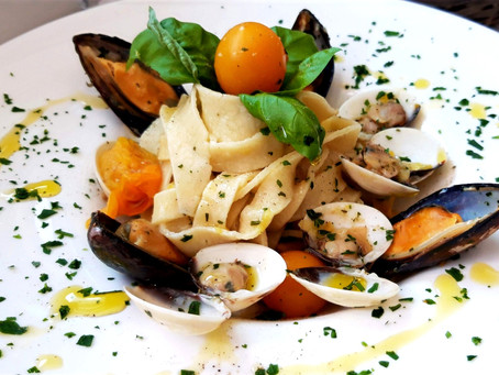 Homemade Tagliatelle with Clams, Mussels and yello cherry tomatoes