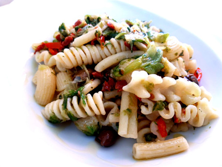 Pasta with Escarole salad, dried Tomatoes, chili, olives and pine nuts