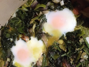 Greens with baked eggs