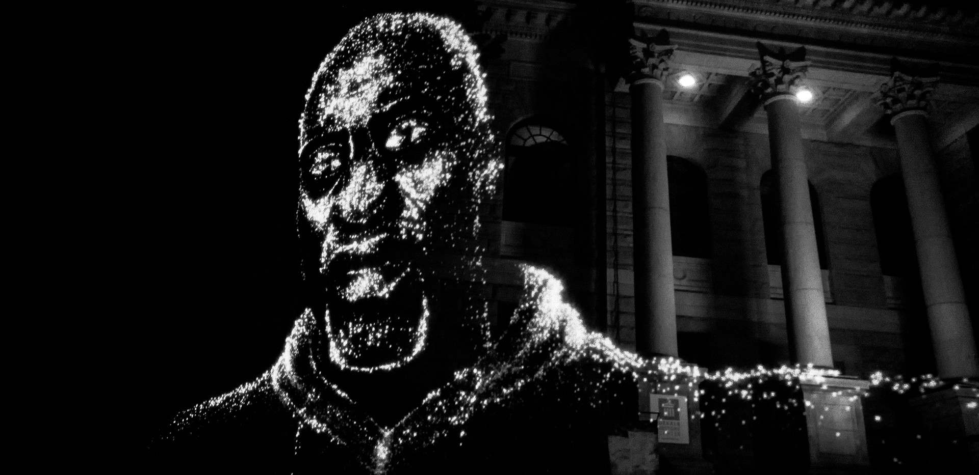 Hologram image of George Floyd, murdered by police in Minneapolis in May 2020, is displayed where a Confederate monument once stood in Decatur Square in Atlanta, GA