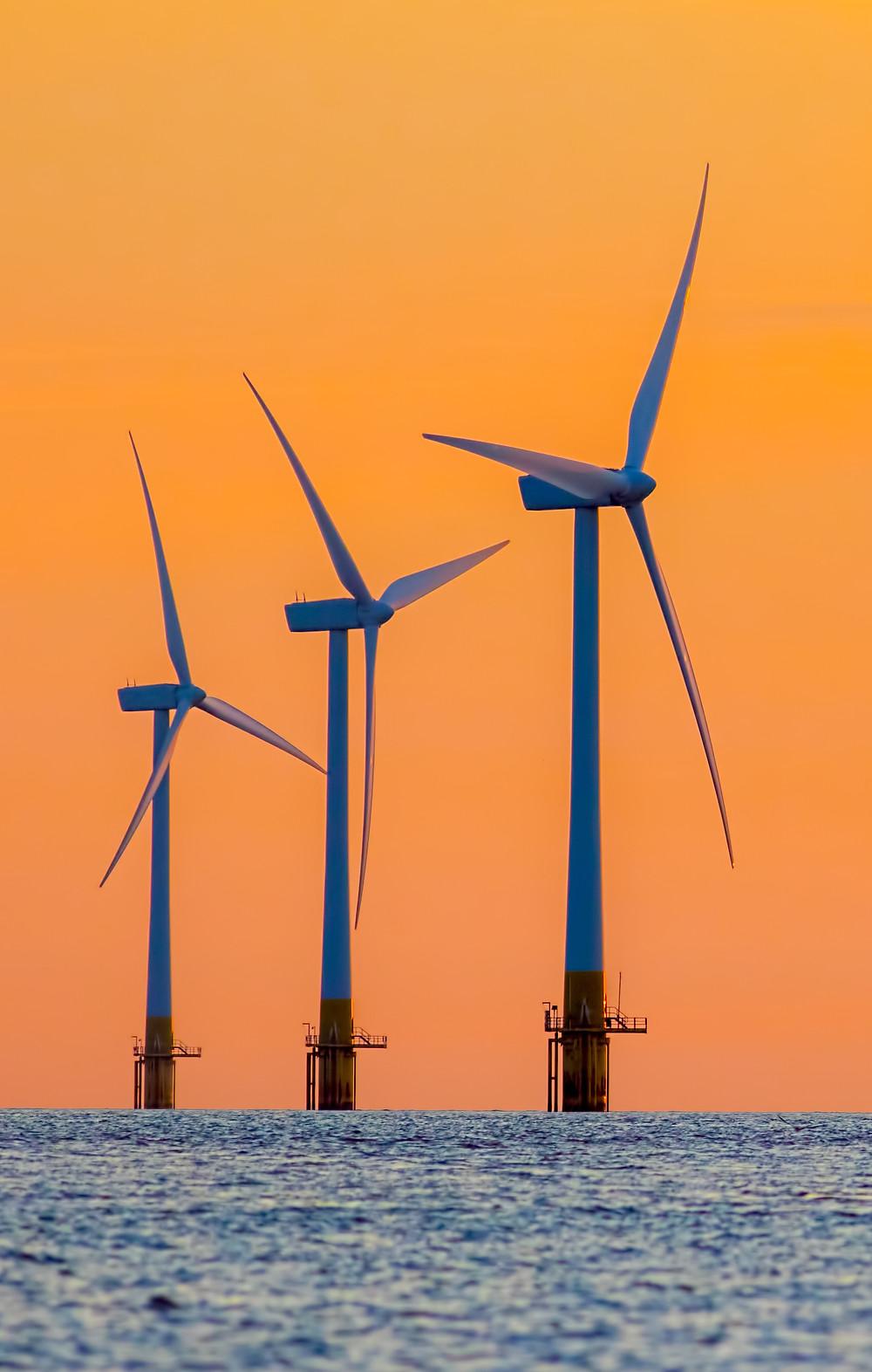 Three wind turbines at dawn